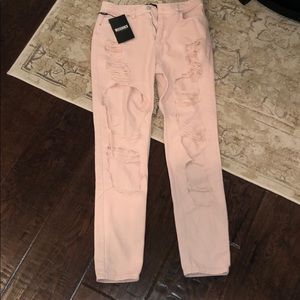Ripped light pink high waisted Misguided jeans